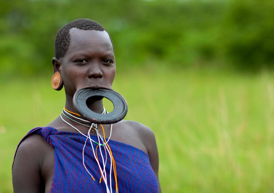 The reason why women wear lip plates is not fully understood, but some suggest it was to deter slavers