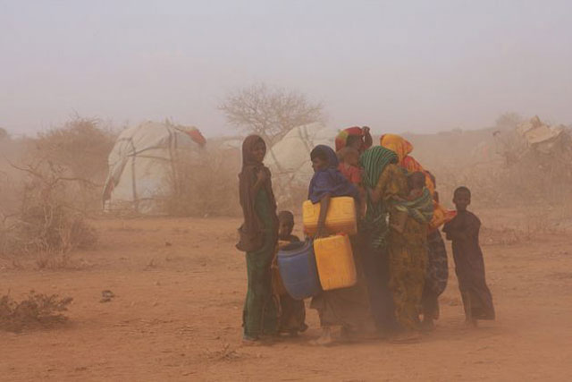 Women and children caught in a dust-laden gust at an IDP settlement 60km south of the town of Gode, reachable only along a dirt track through the desiccated landscape. (Photo: James Jeffrey / IPS)