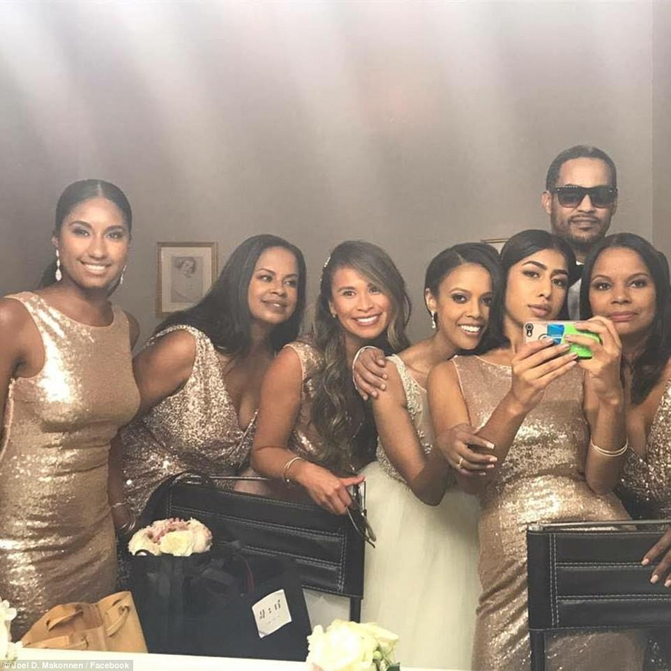 The bridal party pictured with Makonnen in this bathroom shot