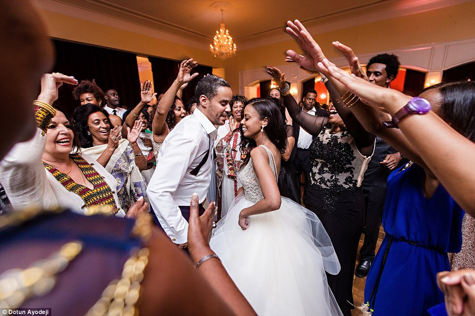 Family and friends surround the newlyweds as they danced at the reception