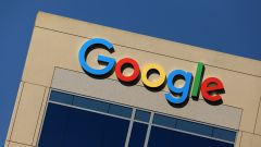 FILE PHOTO - The Google logo is pictured atop an office building in Irvine, California, U.S. August 7, 2017.   REUTERS/Mike Blake/File Picture - RC1F498AE7E0