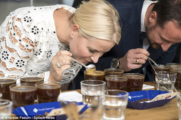 She and her husband were then seen intently sniffing different types of coffee before drinking
