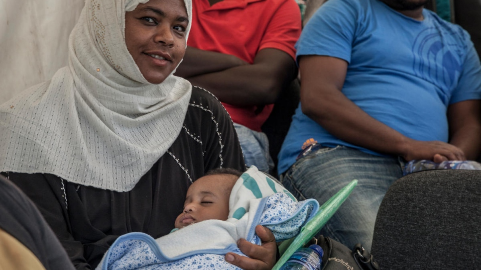 Yemeni refugee mother waits to receive her child's birth certificate. The Government of Ethiopia is issuing legal civil documents to refugees in the country.