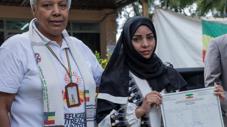 Refugee woman receives her divorce certificate. The Government of Ethiopia is issuing legal civil documents to refugees in the country, including birth, death, marriage and divorce certificates.