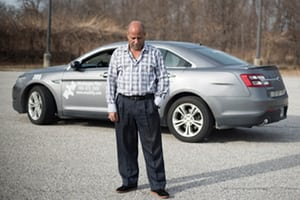 Hailu Mergia in front of his cab.