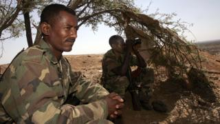 Ethiopian soldiers take advantage of the shade of a tree on 20 November 2005 on a hilltop outpost overlooking the northern Ethiopian town of Badme, in the Tigray region, towards the Temporary Security Zone and the Eritrean border.