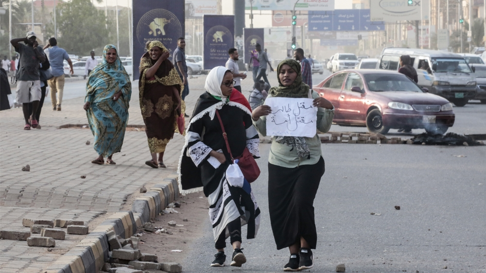Sudanese protesters carry a placard during a rally in the capital Khartoum to condemn the