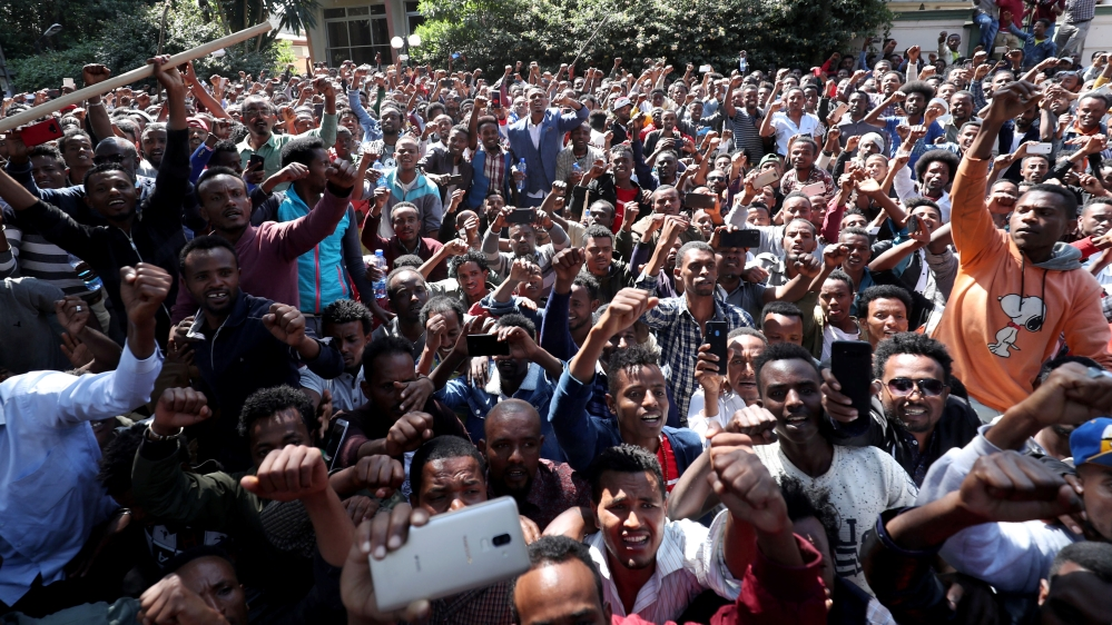 Oromo youth shout slogans outside Jawar Mohammed's house, an Oromo activist and leader of the Oromo protest in Addis Ababa