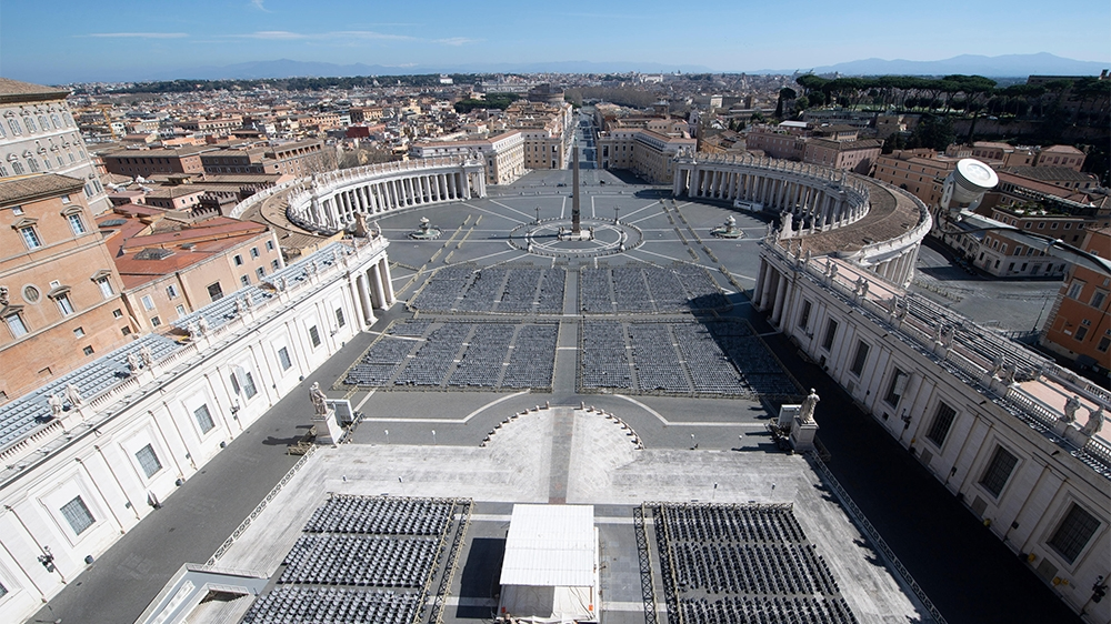 A photo taken and handout by the Vatican Media on March 12, 2020 shows a deserted St. Peter's Square two days after it was closed to tourists as part of a broader clampdown aimed at curbing the corona