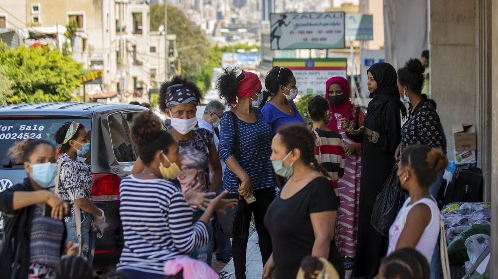 Dozens of Ethiopian domestic workers gather outside the Ethiopian consulate, some inquiring about flights home, others stranded after they were abandoned by employers who claimed they could no longer
